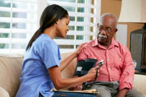 elderly man having his blood pressure checked
