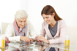 caregiver with her patient playing card game