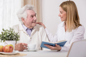 caregiver assisting the senior patient
