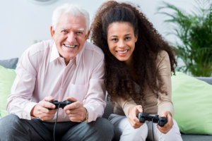 caregiver and patient having fun in playing console game