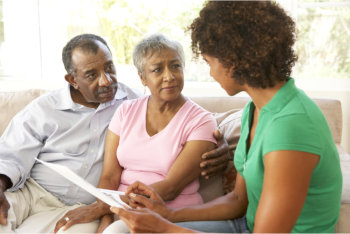 caregiver monitoring the patient's health condition